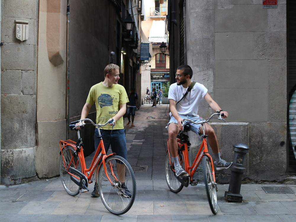 Tourists on rental bikes in Barcelona